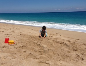 My son playing on the beach
